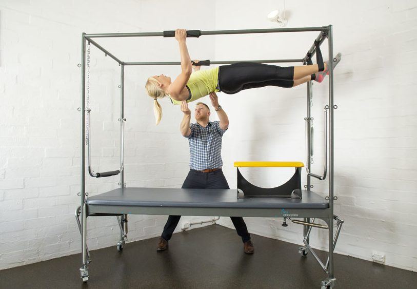 clinical pilates trapeze with client and physio nedlands
